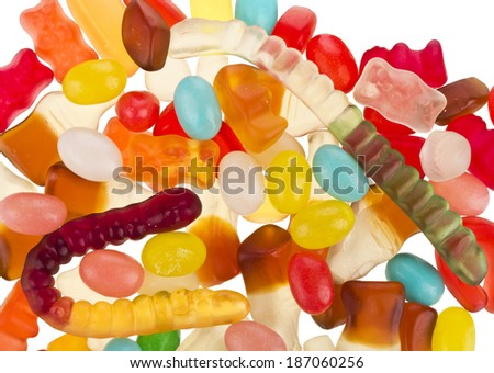 Mixed colorful jelly candies on white background - stock photo