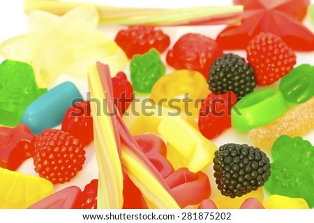 Mixed colorful jelly candies on white background. - stock photo