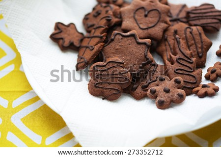 Mixed Cookies on a white plate and napkin - stock photo