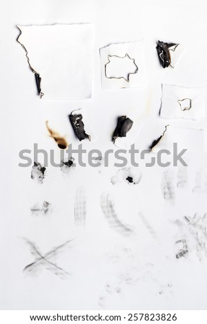 Mixed dirty paper with burnt and coal marks. - stock photo