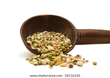 Mixed dried bean soup in a wooden spoon isolated on white. - stock photo