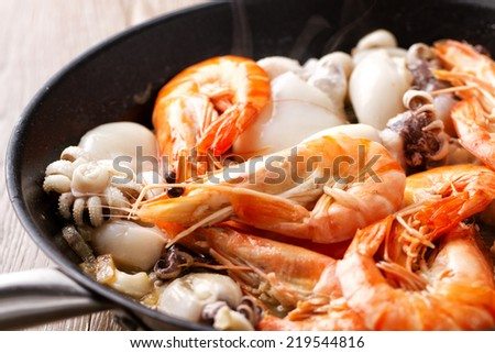 Mixed fish in the pan - stock photo