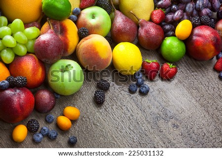 Mixed fresh Fruits on the  wooden background  with water drops and copy space - stock photo