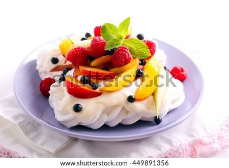 Mixed fruit and berry Pavlova, served on plate