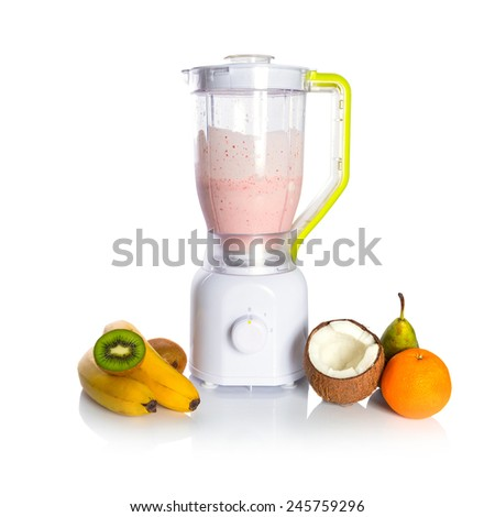 Mixed fruit in blender with fresh yoghurt - stock photo