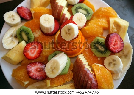 Mixed fruit plate - stock photo