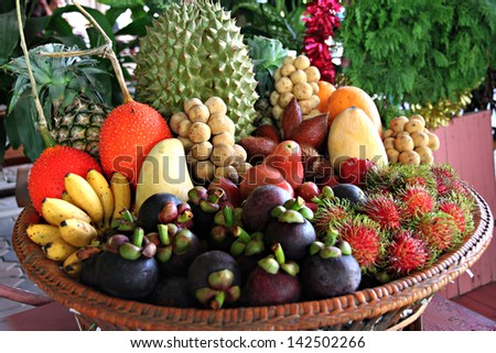 Mixed Fruits in basket and local fruits of Thailand. - stock photo