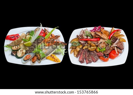 Mixed grill. Assorted fish and meat platter with grilled vegetables. Meat: beef shoulder, grilled chicken, baby-beef, lamb. Fish plate: tiger shrimp, codfish, cod, sea bass, mussels. - stock photo
