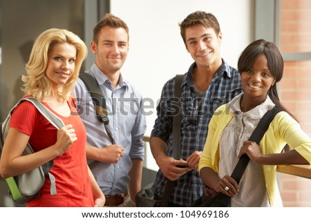 Mixed group of students in college - stock photo