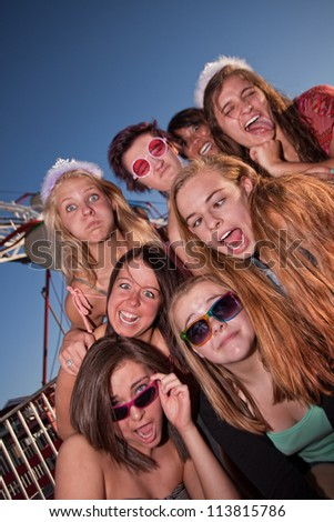 Mixed group of young girls outside making faces - stock photo