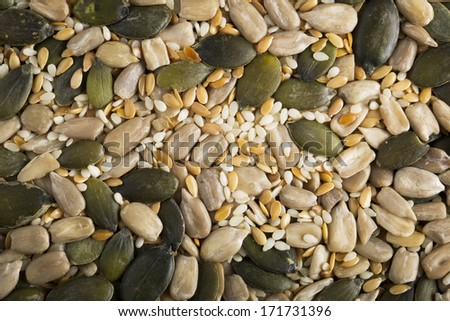 Mixed healthy seeds food background containing pumpkin seeds, sesame seeds and sunflower seeds. - stock photo
