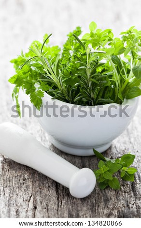 mixed herbs in a mortar - stock photo