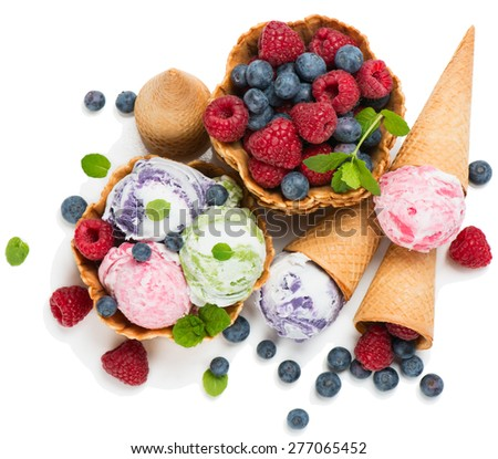 Mixed ice cream and fresh berries isolated on white, top view - stock photo