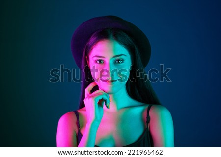 mixed light. attractive young woman on dark