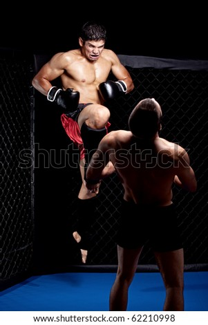 Mixed martial artists fighting - knee strike - stock photo