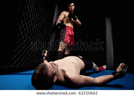 Mixed martial artists fighting - knock out