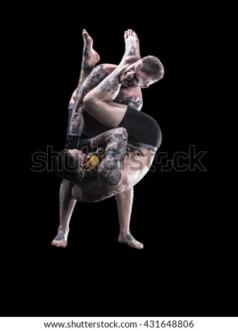 Mixed martial artists fighting on black background - stock photo