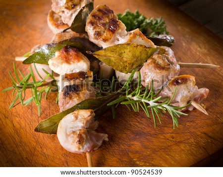 mixed meat skewer on wooden background - stock photo