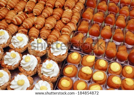 mixed mignon pastries, typical italian sweet food  - stock photo