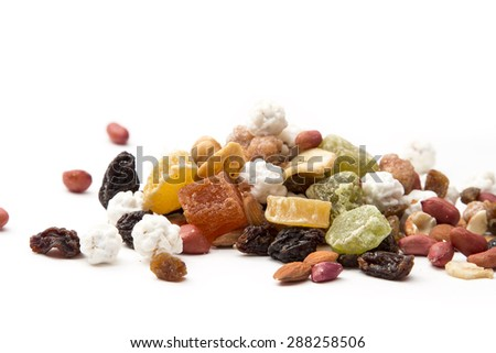 mixed nuts and dried fruit, on a white background - stock photo