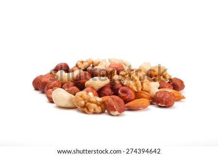 Mixed Nuts. Big pile of different nuts lying  on a white background.