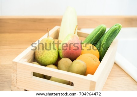 Mixed of fresh Fruits and vegetables  in Wooden Box on Wooden Table.
