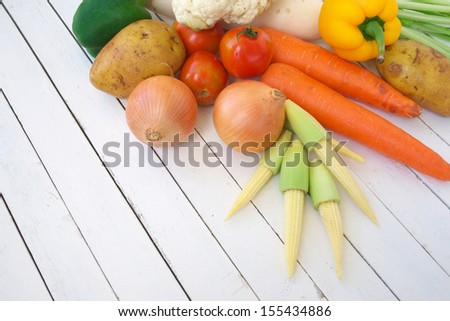 mixed of raw vegetable on white table - stock photo