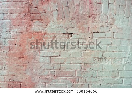 Mixed painted pink with cold white brick wall. Vintage effect.  - stock photo