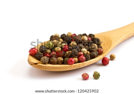 Mixed pepper in wooden spoon isolated on white background