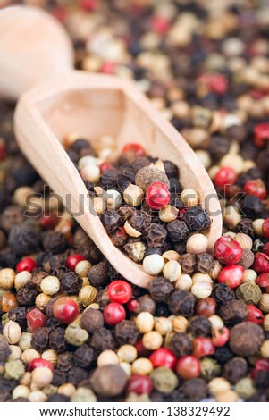 Mixed peppercorns  of wooden spoon