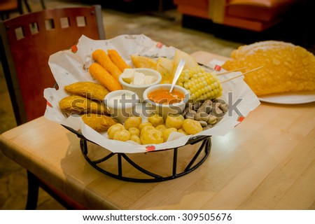 Mixed platter beautifully arranged with mix of typical latin foods such as empanadas, corn, abbas and salsas. - stock photo