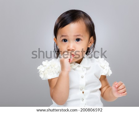 Mixed race baby suck finger - stock photo