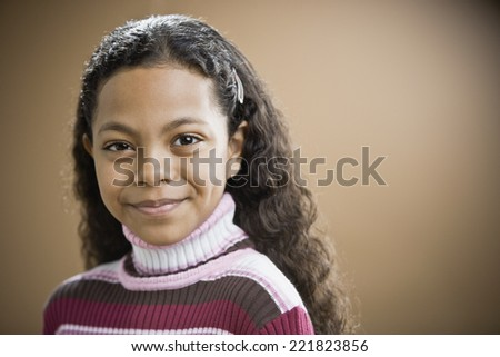Mixed Race girl with barrette in hair - stock photo