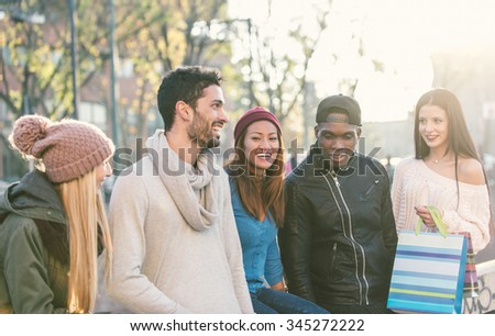 Mixed race group of friends having fun outdoor. concept about people, friendship and autumn - stock photo