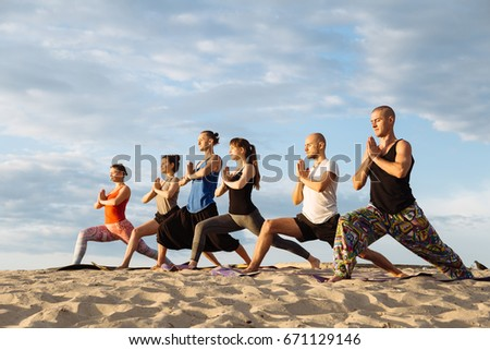 Mixed race group of people exercising yoga healthy lifestyle fitness warrior poses. Health lifestyle concept.