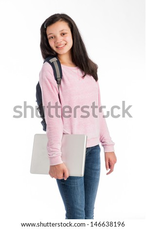 Mixed race teenage girl wearing casual cloths and jeans holding a laptop computer. Isolated on studio white background.  - stock photo