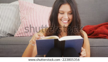 Mixed race woman reading a good book - stock photo