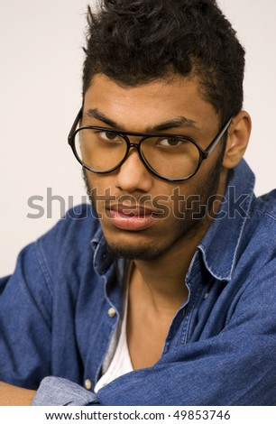 Mixed race youth with serious expression - stock photo
