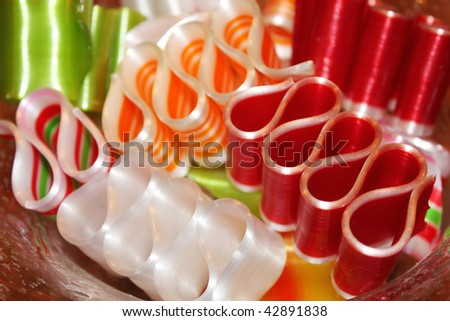 Mixed ribbon candy in a glass bowl - stock photo