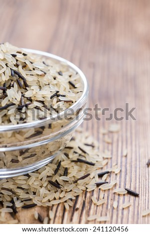 Mixed Rice (with Wild Rice) on rustic wooden background