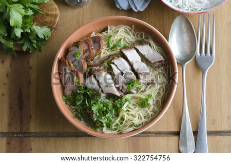 Mixed roast meats with rice noodles in a bowl - stock photo