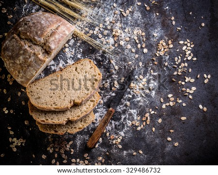 Mixed rye-wheat whole grain homemade sourdough bread - stock photo