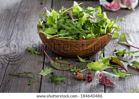 Mixed salad green leaves in a wooden bowl