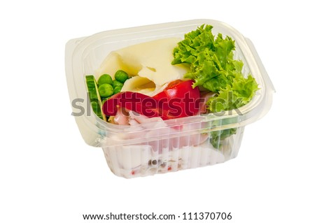 Mixed salad in a box made of cheese, lettuce, tomato, ham etc.