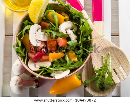 mixed salad with arugula mushroom and capsicum - stock photo