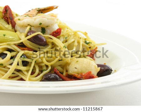 Mixed seafood on a white plate isolated on white - stock photo