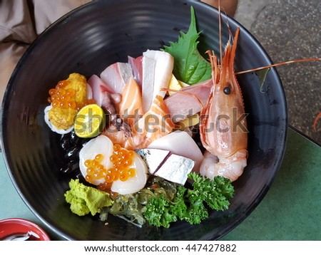 Mixed Seafood sashimi with rice bowl, Called don in Japanese. very cheap and delicious. Taipei, Taiwan 2016 - stock photo