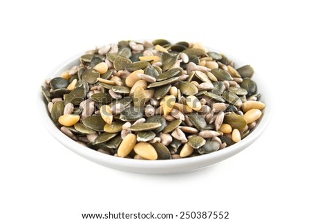 mixed seeds in white bowl - stock photo