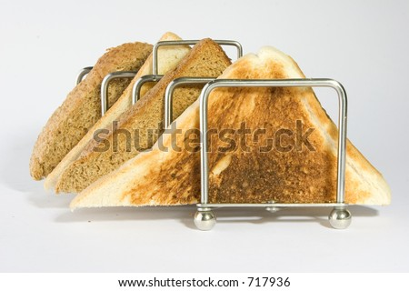 mixed toast triangles in a rack - stock photo