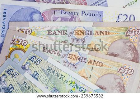 Mixed UK money notes background - stock photo